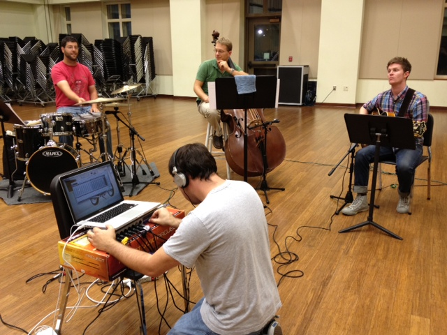 The rhythm section (Aaron Tucker, Jason Foureman, Jared Wofford) with Lucian fiddling with the recording equipment