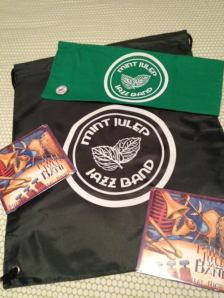 First prize is a CD, bag, hankie, and button - second prize is a CD!